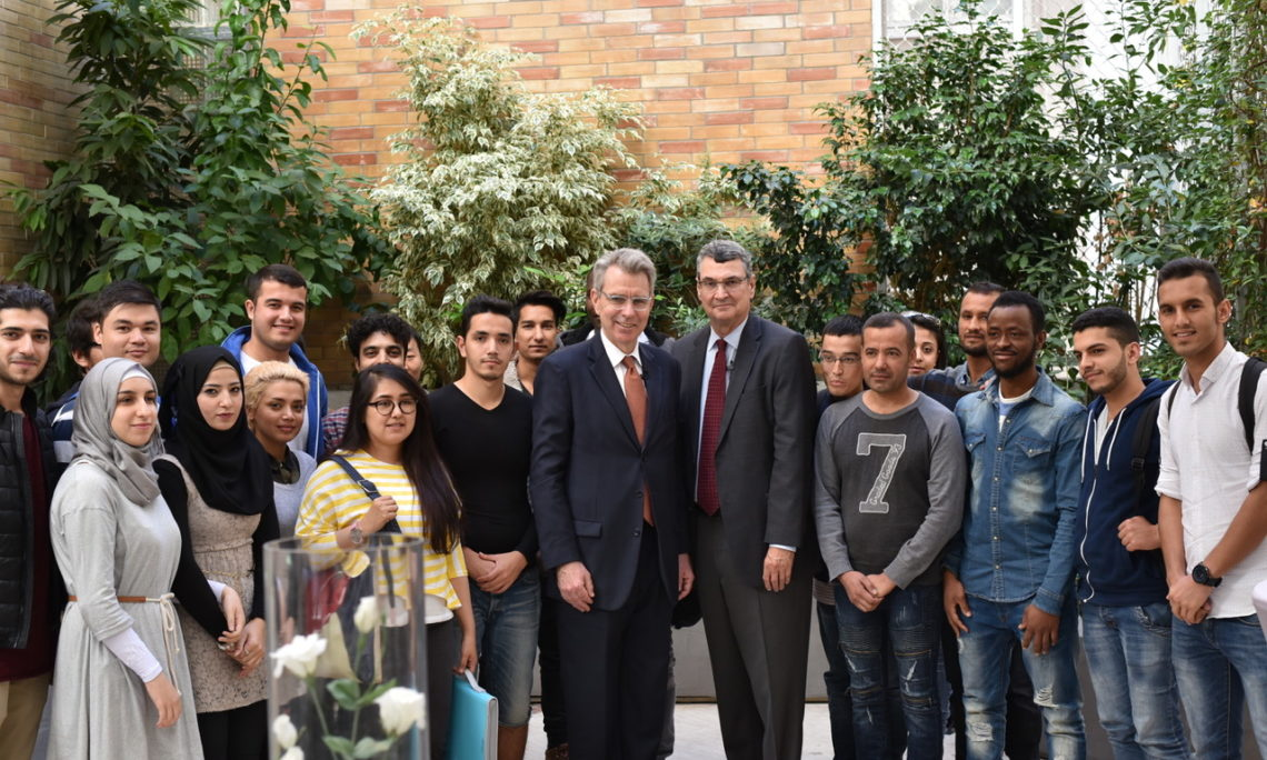 Ambassador Pyatt and President of the American College in Greece David Horner with students